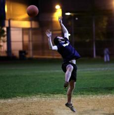 Nick Liberati, playing for Ernest Plays Kickball, leaped but could not catch the ball.